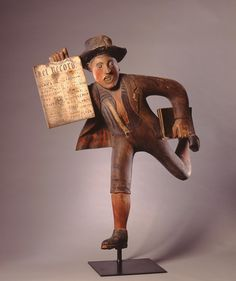 The Newsboy, 1888. Carved, assembled and painted wood with folded tin. American; Milwaukee Museum of Art  42 x 20 x 11 in.