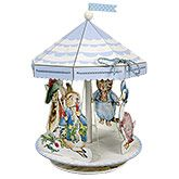 A charming centerpiece for a Peter Rabbit party featuring Peter Rabbit and friends on a merry-go-round.