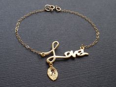 Hey, I found this really awesome Etsy listing at https://www.etsy.com/listing/116777443/personalized-initial-leaf-love-bracelet