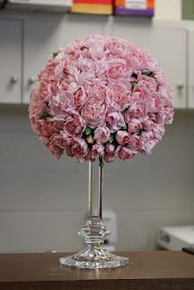 Carnation topiary... Love the candle stick and would look AMAZING with navy stripped table cloths!
