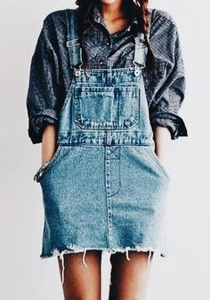 Blue denim overalls over blue print shirt.