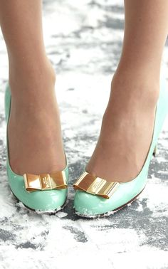 Kate Spade: Mint Pumps with Gold Bow.