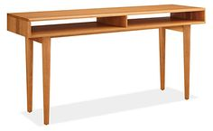 Mid-century details like turned tapered legs and beveled edges lend an air of refinement to our Grove desk. Open design makes cord management a breeze. Handcrafted by Pennsylvania woodworkers, the Grove desk features a natural oil-and-wax finish that showcases the beautiful grain of its solid wood construction.