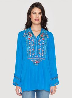 Catra Tunic The Johnny Was CATRA TUNIC is a boho must-have! This tunic top features a colorful embroidery design detailing the henley front, accented by embroidered sleeve hems. Pair this embroidered tunic with a colorful cami and printed pants for the ultimate bohemian look!  - Rayon Georgette - Button Henley Front, Long Sleeves, Tunic Length - Signature Embroidery - Care Instructions: Machine Wash Cold, Tumble Dry Low