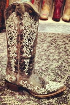 The charcoal color comes in a distressed look giving the boots a rustic feel. The boots are embellished with a lace detail up and down the calf and along the entire foot that make the boots…