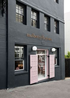 Mulberry & Prince Restaurant in Cape Town by Atelier Interiors. Pastel pink door on black shop facade Italian Interior Design, Cafe Interior, Shop Interior Design, Cafe Design, Retail Design, Design Design, Design Ideas, French Interior, Design Shop