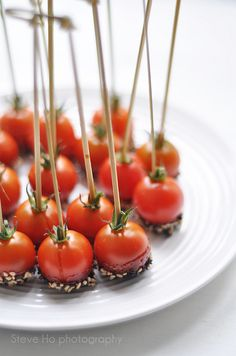 #food_styling  candied cherry tomatoes coated with caramel and back  white sesame seeds