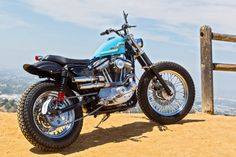 Is it possible to turn a Harley-Davidson Sportster 883 into a capable dirt tracker? Hollywood-based builder Clint Hanaway proves the answer is Yes. Harley Sportster 883, Sportster Scrambler, Harley Davidson Sportster 1200, Harley Davidson Street, Harley Davidson News, Tracker Motorcycle, Scrambler Motorcycle, Motorcycle Garage, Harley Scrambler