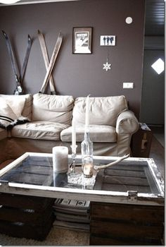 nice couch & coffee table nice wall color - not sure about the skis! I like skiing and chalets but not sure about skis on the wall for me!