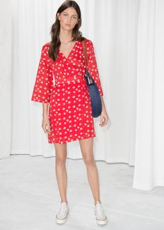 cfdc2000d71 Model front image of Stories flare sleeve wrap dress in red Wrap Dress  Floral