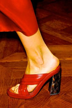 red shoes with marble heels