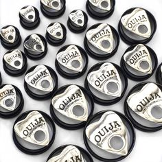 """This is a pair of ear plugs featuring a ouija pendant on the front of black tunnels. The tunnels have an 'o' ring  at the back to secure the plug in your ear.These plugs are available in the following sizes:10mm (00g)12mm (1/2"""")14mm 16mm (5/8"""")18mm (11/16"""")20mm (3/4"""")22mm 24mm (1"""")26mm 28mm30mm*Please note we do not take responsibility for blow outs. Please take into consideration the size and weight when purchasing ear stre..."""