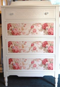 One could Mod Podge pretty wall paper to front of dresser drawers to get this look.