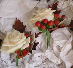 autumnal buttonhole of rose, berry and red oak leaf.