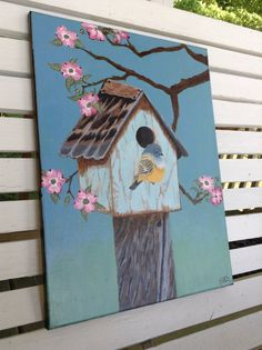 Acrylic painting of a weather beaten blue birdhouse with a grey headed canary perched on the front. Also has a flowering dogwood tree. by Brendyspaintstudio on Etsy