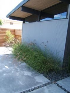 Eichler!- love the exterior finish on this home and the grass and concrete