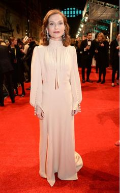 Isabelle Huppert wears a bespoke boho gown by French fashion house Chloe.