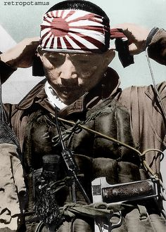 A Kamikaze pilot, armed with an uncommon M. Zulaica y Cia Royal 7.65mm caliber pistol. Produced in Spain during the 1920s, it has a long grip frame holding a 12-round higher-capacity magazine. Japanese officers could buy a foreign weapon to use as their personal sidearm. -