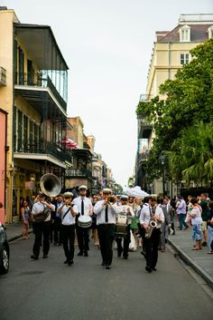 French Quarter New Orleans live jazz procession going down the street! - Bobo & Chichi