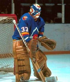 Veteran goalie, Doug Favell, joined the Colorado Rockies via trade prior to the season. In his first season in the Mile High City, Favell helped the Rocki Bruins Hockey, Hockey Goalie, Hockey Games, Ice Hockey, Rangers Hockey, Sports Images, Sports Pictures, Hockey Helmet, Colorado Rockies