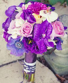 purple wedding bouquet. <3