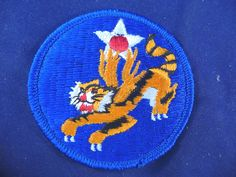 Flying Tigers Patch WWII Military Army Air Navy Marine 2 5/8 inches Collectibles:Militaria:Militaria (Date Unknown):Air Force www.internetauctionservicesllc.com $9.99