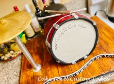 Red and white drumset cake with edible cymbols and real playing music