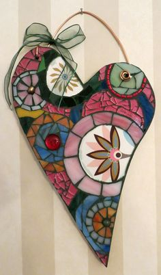 """""""Circles of Love"""" wooden heart with glass mosaic, 7""""x11"""" -- $80. Stained, clear, and crash glass with beads used. Heavy wire for hanger with bow."""