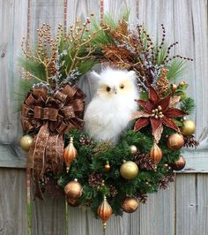 12 inch white feather owl, 18 inch grapevine wreath, artificial pine, gold glitter branches, iced twig branches