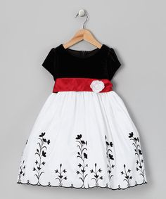 With an elegant embroidered taffeta skirt and velvet bodice, this poufy frock will have any little lady looking like a princess at the next special occasion. A zipper in back makes slipping this dreamy dress on and off easy as pie, while a blossoming belt adds an air of luxury at the waist.