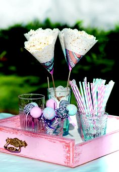 Vintage party theme: It's the little details that pull this theme together. These vintage straws can be bought from In Good Company, and the ribbons on the table from Ebony & Ivory. Lay the strips of lace and ribbon loosely across a plain table cloth.