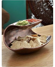 Even though the original is made of metal, the form and design looks interesting and ceramic-friendly (Nambe Metal Heritage Double Dip Server).something to try in clayHeritage Double Dip Server by Nambe. Perfect for your next party to serve your home