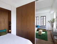 Full height sliding partition hides bedroom when required, Studio Garneau, Remodelista