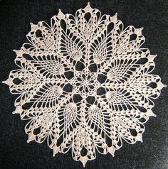 """Crochet lace in pineapple design 11.5"""" / 29cms in diameter Materials - approximately 21g of Coats no. 20 cotton (Just over a ball dammit) and 8 hours of my life. Worked with a 1.25 hook Sheer madne..."""