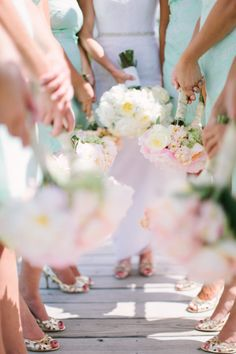 bridesmaids gold pumps and holding white and pink bouquets http://www.itgirlweddings.com/blog/a-charming-seaside-affair