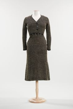 1930 Elsa Schiaparelli wool & leather dress. The buttons across the front waist allude to men's 19th-C fall-front pants, a witty form of decoration for women's clothing. Brooklyn Museum Costume Collection at The Metropolitan Museum of Art, gift of the Brooklyn Museum, 2009; gift of Charles Mergentime in memory of Marguerita Mergentime, 1942. Accession No. 2009.300.3029