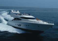 Dominator 62 Fly Yacht Charter, 3 cabins, 6+2 berths. Available in Italy.
