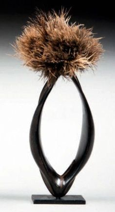 Kenya | Ceremonial man's armlet; buffalo horn, ostrich feathers.  Aged patina.  22 x 8,5 cm | Est. 350 - 450€ ~ (Apr '15)