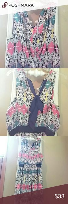 "Sugarlips Tribal Print Party Dress Multicolored tribal print party dress. Ties at back neckline with black ribbon. Black elastic panel runs from sides around back. Plunging front neckline. 35"" long. Worn once- excellent condition. sugarlips Dresses Mini"