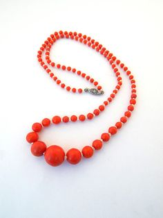 Hey, I found this really awesome Etsy listing at https://www.etsy.com/listing/562369347/vintage-coral-red-celluloid-necklace-10k