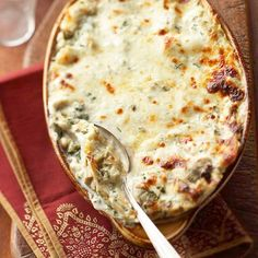 Creamy Artichoke Lasagna Bake -You'll want seconds of this creamy lasagna that doesn't skimp on the cheese -- perfectly sized for a small holiday party, this dish is sure to be a crowd-pleaser.  More casserole recipes: http://www.bhg.com/christmas/recipes/crowd-pleasing-holiday-casseroles/