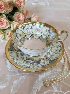 An absolutely stunning vintage Paragon teacup and saucer! Light pink with a garland of white roses and heavy gold. Outside of cup is white, with a gold band. Gorgeous pattern! Fine Bone China – c. 1950s. Excellent vintage condition – no chips, cracks, crazing or repairs. Pattern is