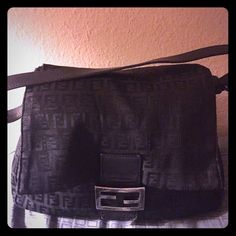 Authentic Vintage Black Fendi Baguette Guaranteed 100%authentic Fendi baguette style handbag!This all black Fendi purse is a classic timeless piece that'll never go out of style.It is the the all black Fendi Zucca monogram print, made out of canvas like material with a leather shoulder strap.The Handbag is meant to be worn on ur shoulder or by hand. In great condition especially for a vintage piece!Signs of wear include:scratches on the hardware,& a few light snags in various places,not…