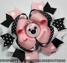 """I love this super cute pink minnie mouse inspired hair bow! The bow is layered with vibrant colors and beautiful ribbon. Each bow pictured measures approximately 4.5""""- 5"""" across. It is perfect for bab"""