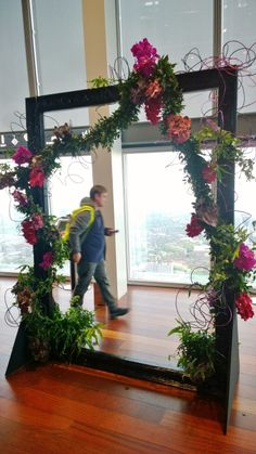 An oversized picture frame for photo opportunities at The Shard. A traditional handmade foliage garland with added Vanda orchids and thick aluminium wire for a younger more edgy look Vanda Orchids, The Shard, Flower Frame, Skates, Bespoke, Picture Frames, Garland, Opportunity, Wire