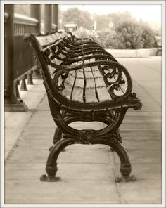 Antique wrought iron bench at historic Revere Beach in Massachusetts.