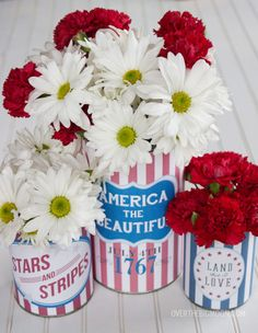 Easy 4th of july decor. Cute way to decorate using tin cans.