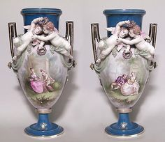 Pair of French Victorian Louis Phillipe porcelain vases with two cupids in relief and painted couple in garden