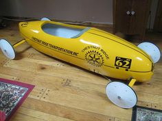"Professional Full Sized Soap Box Derby Racer. Professionally Painted And Built In California. Color, Beautiful Yellow, Lettering: Chestnut Ridge Transportation, Inc. On Both Sides, Chestnut Ridge Rotary International "" 62 "", "" CRT "" On Front And Back, all the lettering again was Professionally Done. 