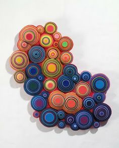 Andrea Cavagnaro is Argentinian textile artist based in Buenos Aires. She creates intricate cut and amazing layered felt sculptures.